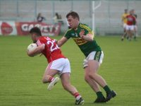 Kerry's Andrew Barry hassles Corks Chris Moynihan. Photo by Gavin O'Connor.