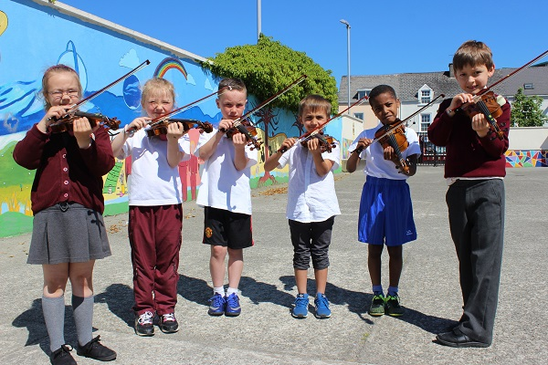 Performing at the Moyderwell National School 'Colour My Strings' concert were from left:: Zuzana Nedes, Greta Ziauberyte, Jack Daly, Oscar Matusiewicz, Saad Abdalla and Micheal Tyther. Photo by Gavin O'Connor.