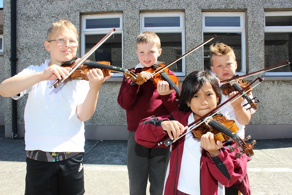 Performing at the Moyderwell National School 'Colour My Strings' concert were from left: Gabriel Iusdargys, Zack Griffin, Geri Samonte and Oliver Zlotocki. Photo by Gavin O'Connor.