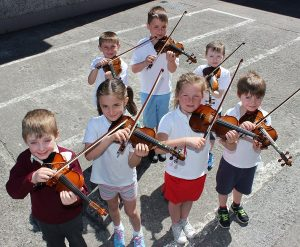 Performing at the Moyderwell National School 'Colour My Strings' concert were from left, front: Brian McElligott, Christina Lopez, Rosie Quilligan and Lewis Hughes. Back: Stan Ignatov, Evo Falinski and Rhys Jones. Photo by Gavin O'Connor.