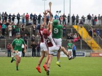 Ballyduff's Mikey Boyle rises high with Eoin Ross and Sean Browne of Causeway. Photo by Gavin O'Connor.
