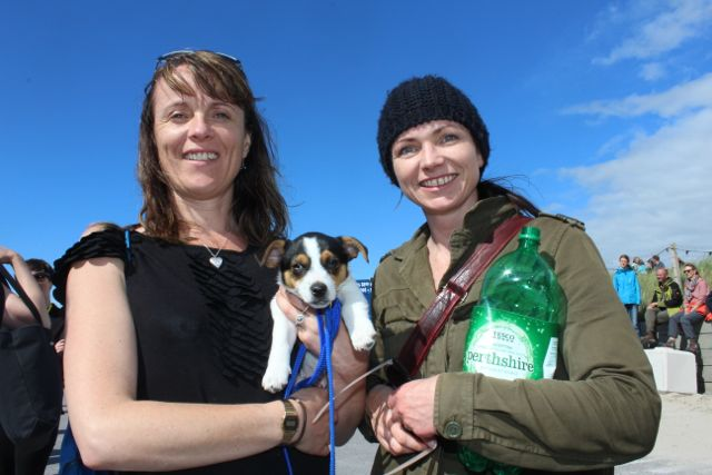 Brigid Moriarty, Kilorglin, holding Oscar and Aileen Kingerlee, Killarney, at the Feile Failte at Banna Beach on Saturday. Photo by Dermot Crean