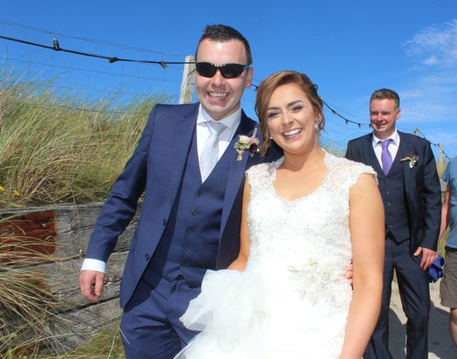 Just married...Patrick Browne and Marie Browne (nee O'Riordan) from Rockchapel making their way to the beach at the Feile Failte at Banna Beach on Saturday. Photo by Dermot Crean