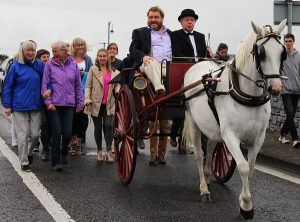 Brendan Grace coming over Blennerville bridge with Derry Kelliher at the reigns. Photo by Gavin O'Connor.