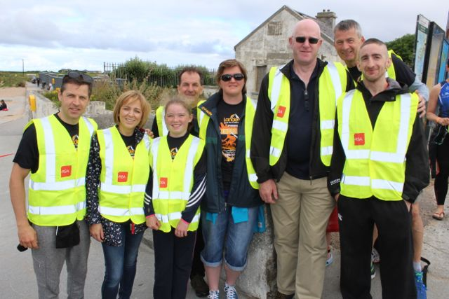 Stewards Padraig Kelly, Sharon Allman, William Harnett, Aoibhin Ni Loingsigh, Sarah O'Donnell, Eamonn Allman, Sean Reidy and Joe Roche at the Tri Kingdom Come Triathlon in Fenit on Saturday morning. Photo by Dermot Crean