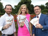 Mike Moriarty of Il Forno Wood Fired Pizza and Restaurant, Rose of Tralee Elysha Brennan and John Drummey, President Tralee Chamber Alliance launching the booklet on  Monday afternoon in the Town Park. Photo by Dermot Crean