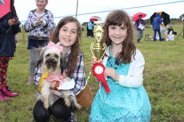 Bey and Hazel Guilfoyle with 'Snooper', winner of Best Dressed Dog at the Open Day at Churchill Forge on Saturday. Photo by Dermot Crean