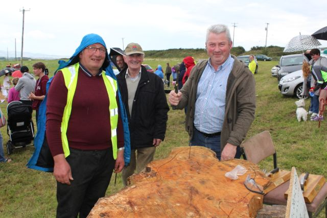 Jim McCarthy about to have a go at the 'Nail-Driving' competition watched by Jimmy Sullivan and Brian O'Daly at the Open Day at Churchill Forge on Saturday. Photo by Dermot Crean