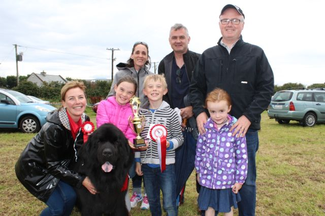 In front; Clodagh O'Dowd, 'Harley' the dog, Clara O'Dowd, Keelan O'Dowd and Grace Stephenson. At back; Darragh Stephenson, Niall O'Dowd and Paul Stephenson at the Open Day at Churchill Forge on Saturday. Photo by Dermot Crean