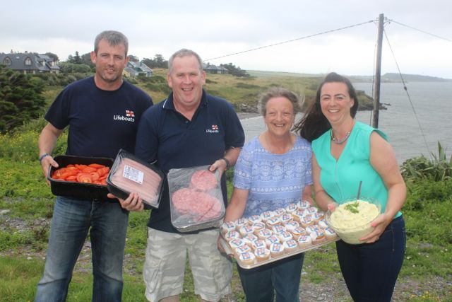 Lee Sugrue, John Williams, Jan Bolt and Jennifer Williams at the barbecue in aid of Fenit Lifeboat on Saturday night. Photo by Dermot Crean