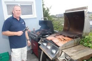 John Williams at the barbecue in aid of Fenit Lifeboat on Saturday night. Photo by Dermot Crean