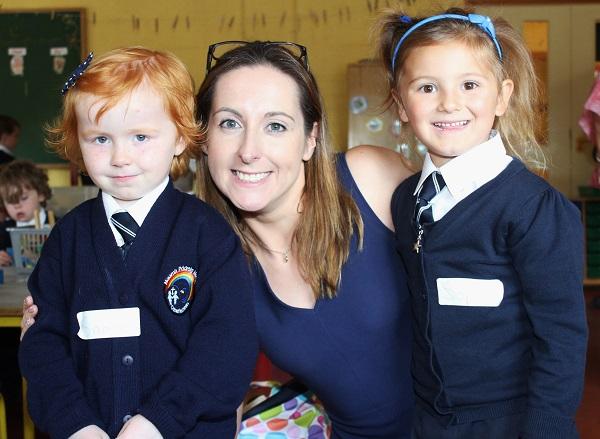 Caherleaheen National School Junior Infant pupils Saoirse Moynihan and Spphia Polak with teacher Adrian Heislip. Photo by Gavin O'Connor.
