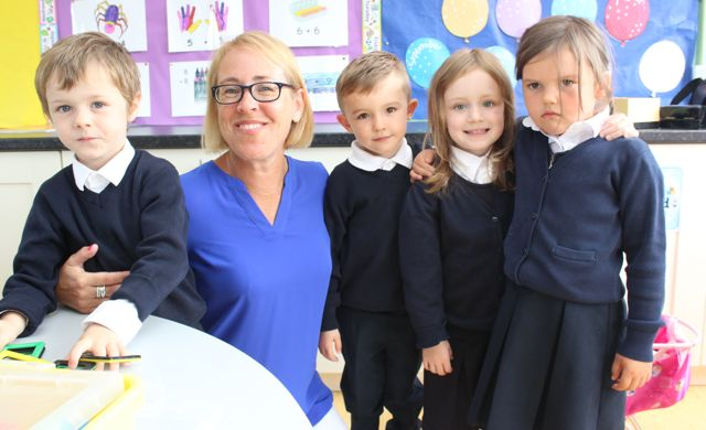 Teacher Fiona Cooke with junior infants Ruben Murphy, Conor McCarthy, Sophie McKenna and Julia Roche on their first day at school at Flemby NS on Wednesday. Photo by Dermot Crean