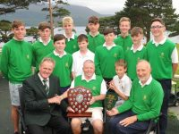 Jack Buckley, Captain of the  Federation of Co.Kerry Golf Clubs, presents the winning trophy to Tralee Golf Club team manager Gatt Carey following Tralee's win in the Kerry Junior League competition at Killarney Golf and Fishing Club.  Also seated are Mark Gazi and  Liam Nolan, Tralee Golf Club Captain. Standing from left are Cian Hill, Michael O'Gara, Mark Stephenson, Eoin Lynch, James McCarthy, Ciaran Nolan-Tighe, Evan O'Connor, John Holmes, Mark Leahy and David Nolan-Tighe.  Picture: Eamonn Keogh