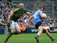 Kieran Donaghy attempts to hault the run Ciaran Kilkenny yesterday. Photo by Dermot Crean.