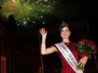 Rose of Tralee , Maggie McEldowney, in front of the Ashe Memorial Hall with Midnight Madness in full flight. Photo by Gavin O'Connor.