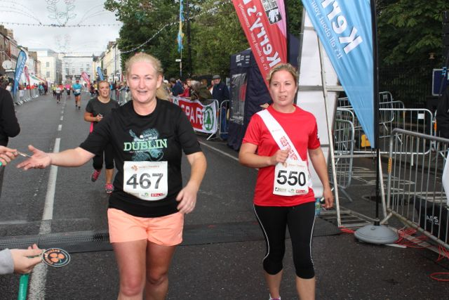 Participants cross the finish line at the Rose of Tralee 10k Run on Sunday afternoon. Photo by Dermot Crean