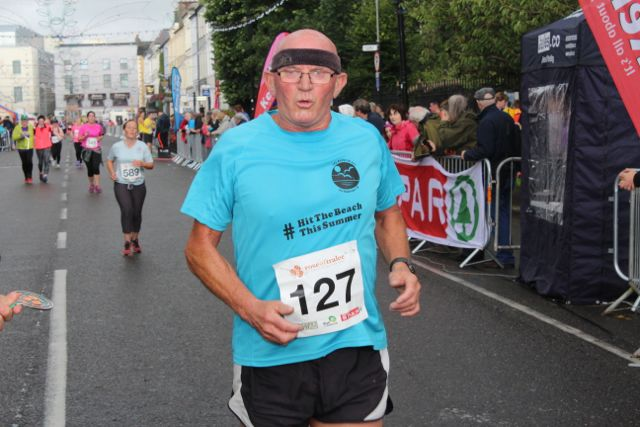 A participant crosses the finish line at the Rose of Tralee 10k Run on Sunday afternoon. Photo by Dermot Crean