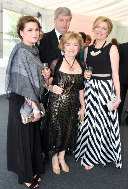 Mary McCarthy, Joan Cunningham, Caitriona Hobbert and at back, Kevin Cunningham at the Rose Ball on Friday evening. Photo by Dermot Crean