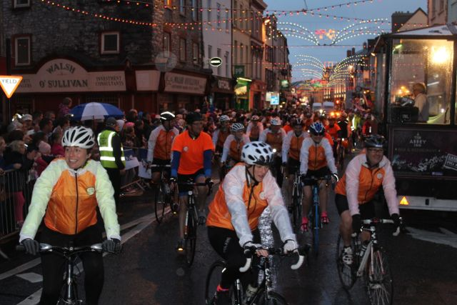 Participants in the Cycle Against Suicide make their way through town on Saturday night. Photo by Dermot Crean