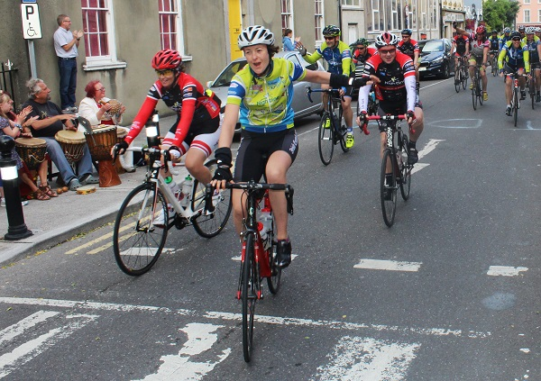Cyclists get over the line at the Tpour de Munster stop off in Tralee. Photo by Gavin O'Connor.