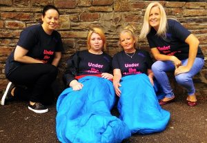 Members of the Under The Elements homeless awareness group are, from left: Charlene Tidings, Marian Coffey, Julie Fitzpatrick and Marilyn O' Shea. Photo by Gavin O'Connor.