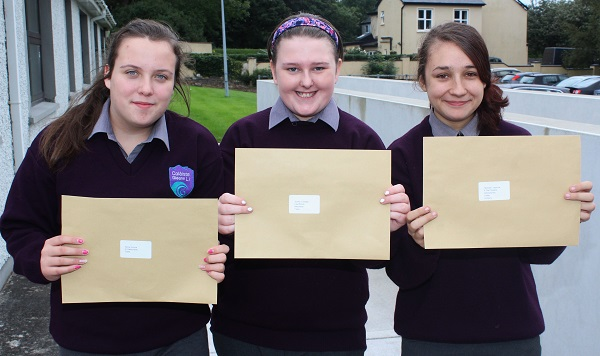 Emma Byrne, Clodagh Quirke and Yasmine McGrath receiving their Junior Cert results in Coláiste Gleann Lí. Photo by Gavin O'Connor.