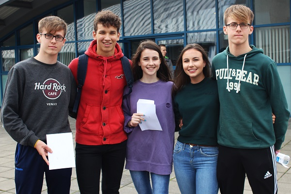 Niall Hurley, Seamus Harty, Iona O'Neil, Emma Godley and Tadhg Hurley receiving their Junior Cert results in Mercy Mounthawk. Photo by Gavin O'Connor.