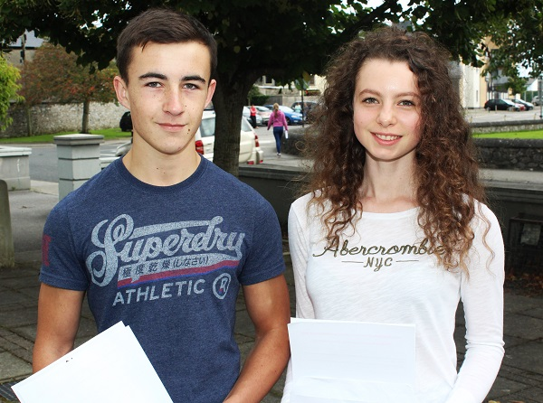 Cael Ó Duibhghiolla and Maggie Ní Nualláin receiving their Junior Cert results in Gaelcholáiste Chiarraí. Photo by Gavin O'Connor.