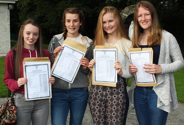 Roisin Moriarty, Caennat Moore, Ciara Boyd and Emily Molloy receiving their Junior Cert results in Presentation Secondary School. Photo by Gavin O'Connor.