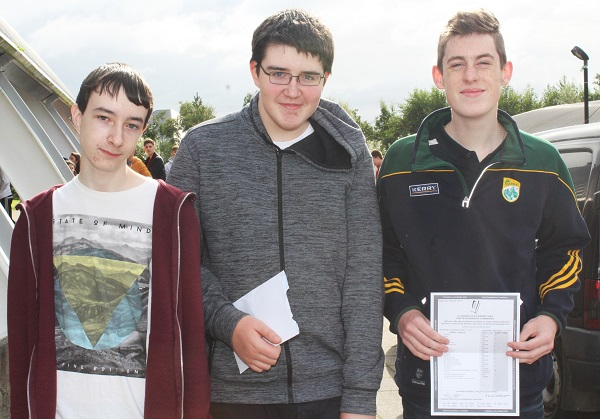 Jason O'Sullivan, Zyndir Griffin and John O'Mahony receiving their Junior Cert results in Mercy Mounthawk. Photo by Gavin O'Connor.