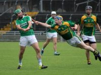 Mikey Boyle gets his shot away despite Dougie Fitzell's efforts. Photo by Dermot Crean