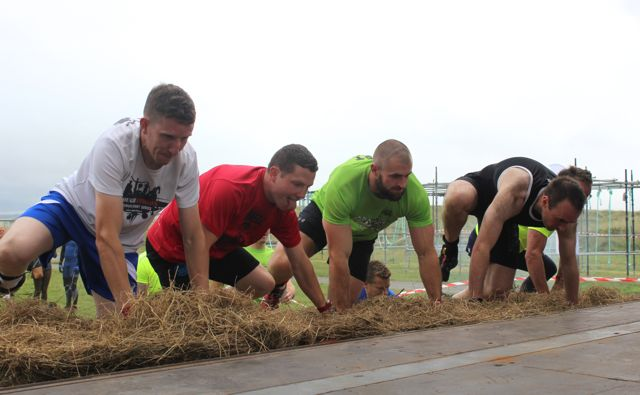 Lads get over the first hurdle at the start of the Banna Beast Challenge on Saturday. Photo by Dermot Crean