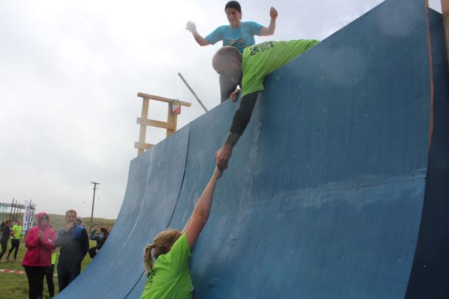 Hang in there...a participant tries to get over the final obstacle at the Banna Beast Challenge on Saturday. Photo by Dermot Crean