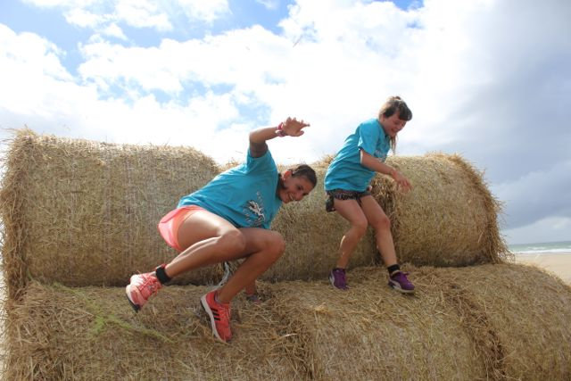 They look happy to get over this obstacle at the Banna Beast Challenge on Saturday. Photo by Dermot Crean