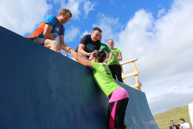 You can do it...one last effort to get over the final obstacle at the Banna Beast Challenge on Saturday. Photo by Dermot Crean