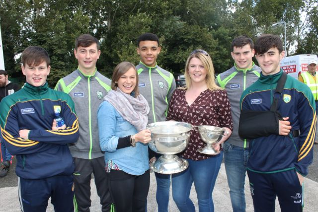 Teachers Aoife Costello and Rebecca Tobin holding the Tommy Markham Cup and the Minor B All-Ireland Hurling Cup with Kerry hurling and football minors Sean O'Donoghue, Tomas O'Connor, Stefan Okunbor, Kieran Dwyer and Niall O'Mahony at the CBS The Green Fun Run on Sunday afternoon. Photo by Dermot Crean