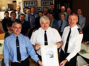 At the coffee morning in aid of Ceejay McCardle in Tralee Garda Station were, front from left: Garda Niall O'Connor, Chief Superintendent Con Cadogan and Superintendent Jim O'Connor. Photo by Gavin O'Connor.