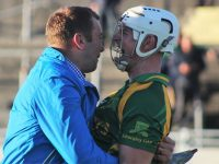 Shane Brick celebrates at the final whistle with a Kilmoyley man. Photo by Gavin O'Connor