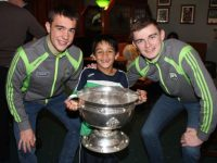Young Shane O'Donovan meets Kerry minors Ryan O'Neill and Diarmuid O'Connor at the Na Gaeil GAA Clubhouse on Friday night. Photo by Dermot Crean
