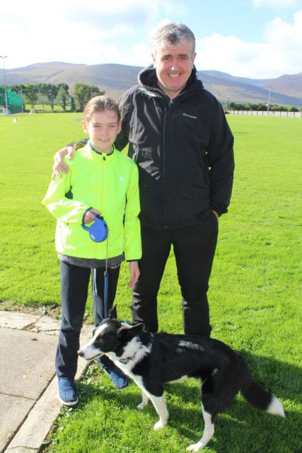 Caoimhe and Dan O'Sullivan with Lassie at the Tony O'Donoghue Memorial Walk at St Pat's GAA Club on Sunday. Photo by Dermot Crean