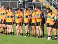 The Austin Stacks team stand for the national anthem. Photo by Dermot Crean