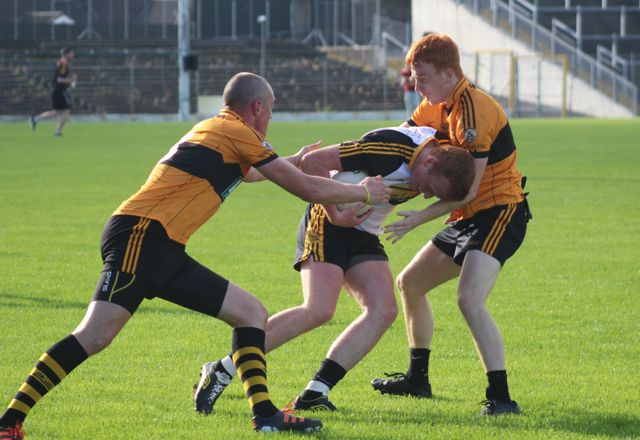 Johnny Buckley is tackled by Kieran Donaghy and Shane O'Callaghan. Photo by Dermot Crean