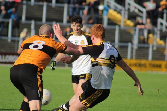 Kieran Donaghy attempts to block Johnny Buckley's shot. Photo by Dermot Crean
