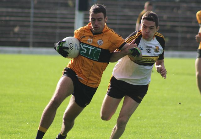 Fiachna Mangan on the attack chased by Brian Looney. Photo by Dermot Crean