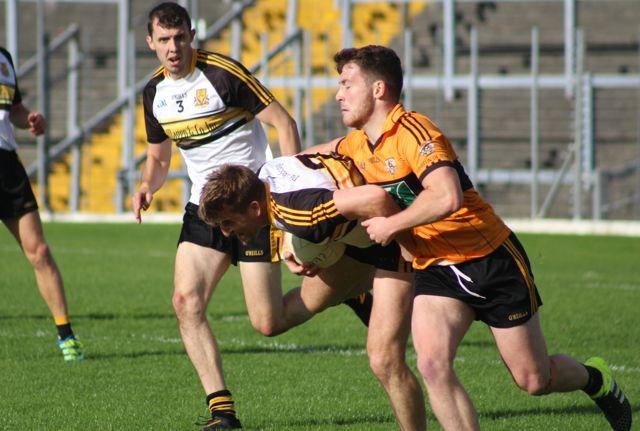 Conor Jordan tackles Mike Milner. Photo by Dermot Crean