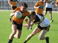 David Mannix goes past Gavin White of Dr Crokes in the senior club final earlier this month. Photo by Dermot Crean