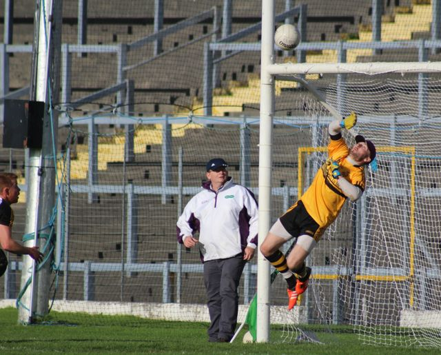 Shane O'Callaghan's patted ball loops over the head of Dr Crokes' Shane Murphy for Austin Stacks first goal. Photo by Dermot Crean