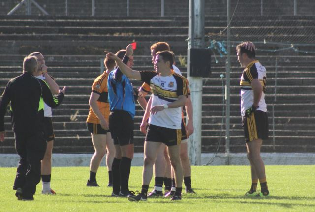 Dr Crokes number 9 Ambrose O'Donovan receives a red card from referee