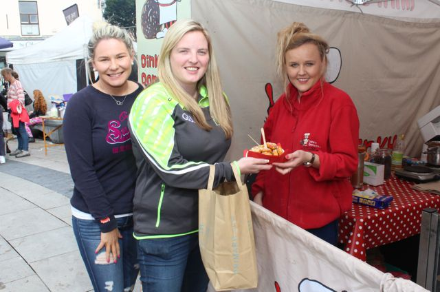 Ciara O'Connor and Maura Lyons of Abbeyfeale getting some Dinky Donuts from Laura Smith at the Artisan Food Market at the Tralee Food Festival on Saturday. Photo by Dermot Crean